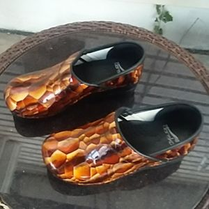 Dansko brown tones snakeprint clogs